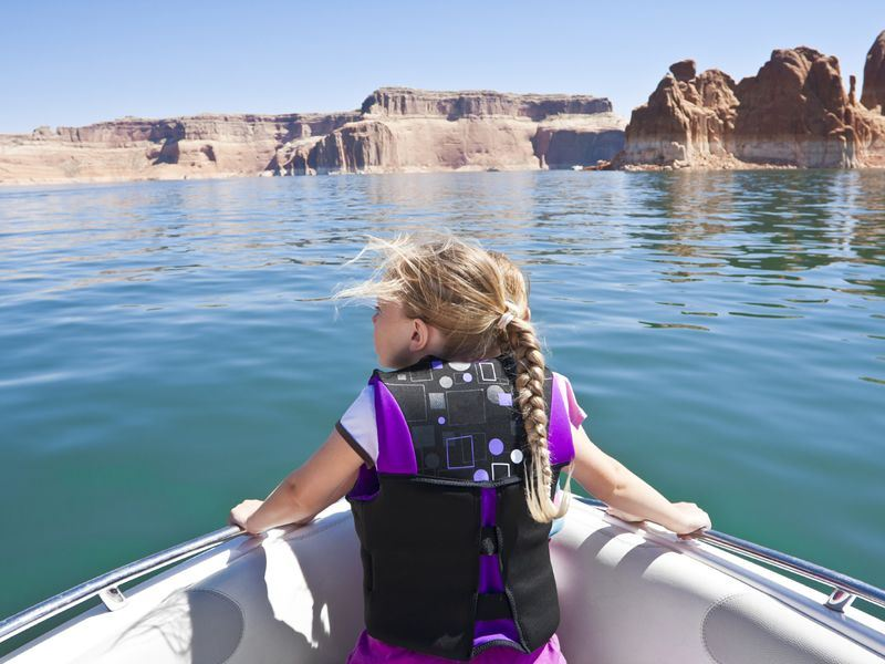 girl on a boat at lake powell