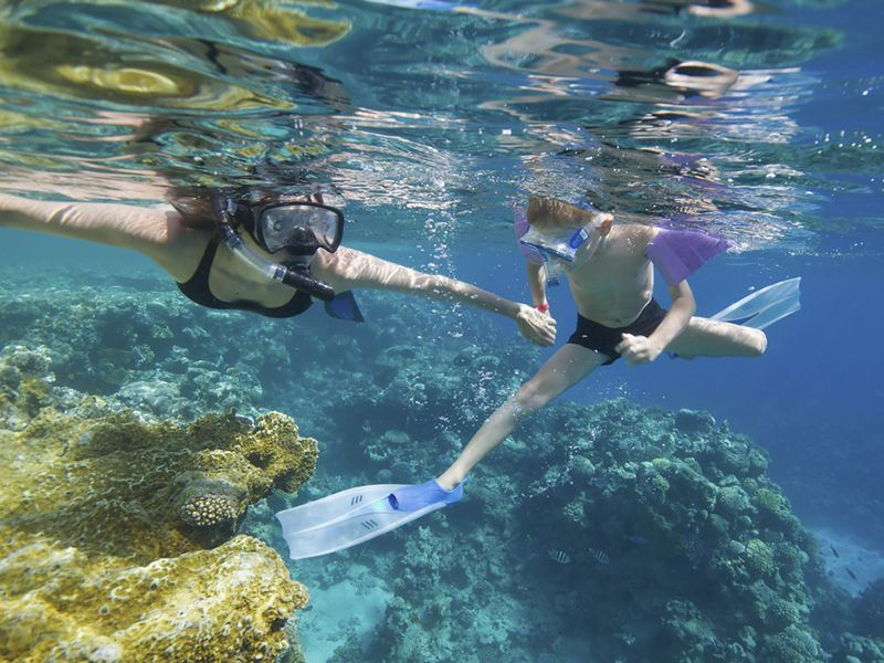 mother and child snorkel in the caribbean
