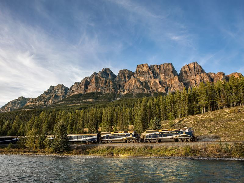 rocky mountaineer passing castle mountain on the first passage to the west route