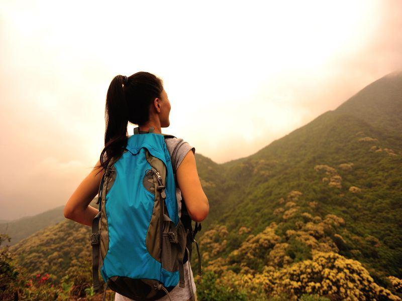 woman hiking on mountain top