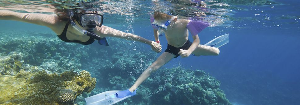 Mother and child snorkelling in the Caribbean